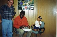 2000 - Larry Jones, J.B. Martin and Jaria<br /> looking at the Iowa Memorie's book