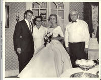 John, Sr., Mildred, Frindy and Milton standing next to wedding cake in dining room