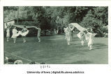 Women in costume dancing outside with large scarves, The University of Iowa, June 1924