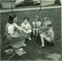 Woman reading to children outside, The University of Iowa, May 28, 1941