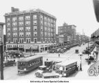 Busy downtown scene near Racine's Cigar Store and Hotel Jefferson, Iowa City, Iowa, between 1920 and 1925