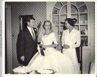Frindy, John, Sr. and unknown woman standing in dining room