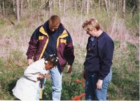 2002 - Soil Conservationist Troy Deutmeyer helps girl scouts plant trees