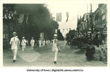 Burlington, Iowa marching band in parade, The University of Iowa, 1910s