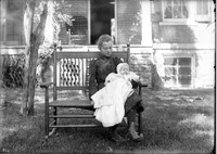 UP608 Woman and infant in rocker