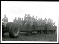 Tractor Pulls a Group of Soil Conservationists for a Site Visit