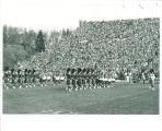 Scottish Highlanders marching at Kinnick Stadium, The University of Iowa, 1960s?