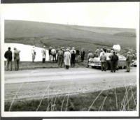 Crowd Observes by the Roadside