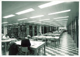 Students studying in Main Library at tables, the University of Iowa, April 1970