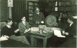 A.O. Thomas teaching with pearly nautilus fossils, The University of Iowa, January 1929