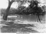 City Park pond and canoe, Iowa City, Iowa, between 1915 and 1920