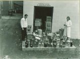 Pharmacy students checking deliveries to pharmacy laboratory, The University of Iowa, 1940s