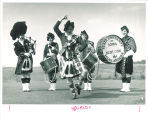 Lynn Whenshell with Scottish Highlanders performing drum dance, The University of Iowa, 1963