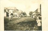 Men riding horses in parade, Redfield, Iowa, August 26, 1908