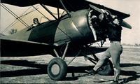 0011_Norman Van Grop, Flight Instructor Spinning the Propellor