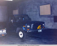 Truck parked inside barn with covered windows