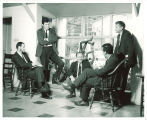 Edmund Keeley, Mark Strand, Vance Bourjaily, Paul Engle and R.V. Cassill in Writers' Workshop headquarters, The University of Iowa, 1960s