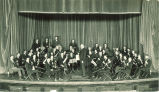 University orchestra with its conductor, Prof. Kendrie, The University of Iowa, 1920s