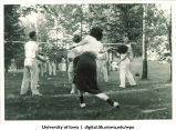 Badminton at a picnic, The University of Iowa, 1930s