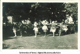 Women in costume running on the Pentacrest at a June celebration, The University of Iowa, 1920