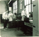 Pharmacy students working in laboratory, The University of Iowa, 1940s
