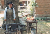 Blacksmith in Museum of Amana History yard, Amana, Iowa, June 1988