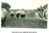 Students racing in a track meet, The University of Iowa, May 17, 1923