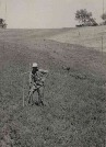 Unidentified people photographed in field and pasture