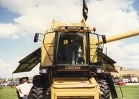 1997 - District Conservationist J.B. Martin Sits in Caterpillar Combine at Ag Expo 1997