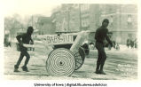 Cart carrying  baby King Tut in Mecca Day parade, The University of Iowa, 1923