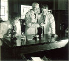 Dean Wilbur J. Teeters with pharmacy students, The University of Iowa, 1940s