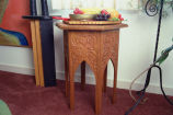 Carved six-sided table