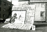 Homecoming lawn display of headlines announcing Cy's Berg Arrives; Stops Jayhawks Cold, 1977