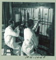 Performing experiments in the Chemistry Building, the University of Iowa, 1950s?