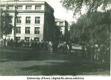Students lined up on Pentacrest for registration, The University of Iowa, 1940s