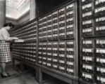 Woman at card catalog in upper rotunda lobby