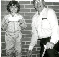 Unidentified child holding a certificate