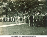 Women walking past registration line, The University of Iowa, 1920s