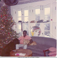 Ainsley Benard sitting on couch at Christmas with Victoria and Sadie