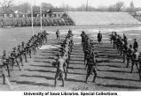 Cadets bayonet training among four ranks, Iowa Field, The University of Iowa, 1919