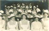 Nurses sitting at dinner tables, The University of Iowa, 1915