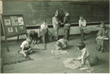 First-graders making Native American costumes, The University of Iowa, February 1931
