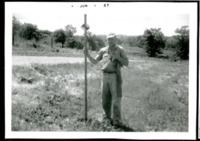 Man Surveys Farmland