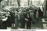 Crowd gathered in front of Iowa Memorial Union for convocation with Pentacrest in background, The University of Iowa, 1930s?