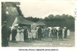 Students gathered near tents for Senior Frolic, The University of Iowa, 1914