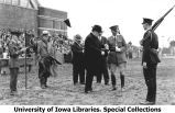 Cadet receiving medal from Governor William L. Harding east of new Armory building, The University of Iowa, 1920