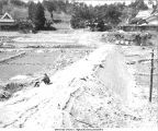 Ozaki Masutaro inspecting new pond levee construction,  Shinkyo commune, Nara-ken, Japan, 1965