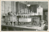 Chemical glassware on laboratory table, 1938