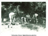 Using different camp cooking devices at Marjory Camp, The University of Iowa, Jul. 22, 1931