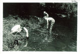 Students by stream at Iowa Lakeside Laboratory, West Lake Okoboji, 1960s?
